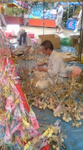 Preparing and selling galic talismans at the Ichinoya Yasaka Jinja 2009