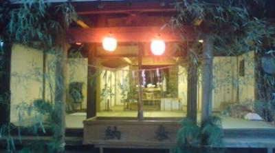The worship hall opened up and decked out with freshly cut bamboo leaves on the night of the Tachibana Hanabi Festival at Teshirogi`s O-Washi Shrine (2010)
