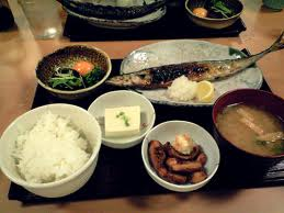 A typical Japanese lunch- Yakizakana teshoku (a set meal), featuring rice, miso soup, tofu, pickles and a grilled SAMNA with a little grated radish on the side