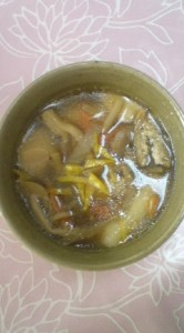 Junko Takasaki`s O-Zoni (2011) in the style of Iwaki (Fukushima Prefecture)-Taro,Carrots, burdock, fried tofu, mushrooms, leaks and chicken in a soy sauce based broth- topped with citron (yuzu) peel shavings