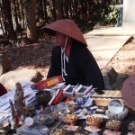 A talisman salesman/ reiki healer had a booth set up near the shrine