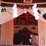 For a fee, some worshippers enter the Main Hall to be blessed/purified by the priest