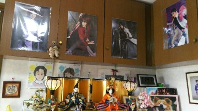 Hina dolls displayed beneath posters of Takarazuka (all-female) review stars