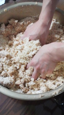 Blending the mushy mixture of mashed soy beans, salt, and KOJI by hand brings back brings out the child in you again