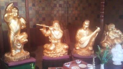 Golden Shichifukujin statues at Tsukuba`s Sansui-tei Restaurant