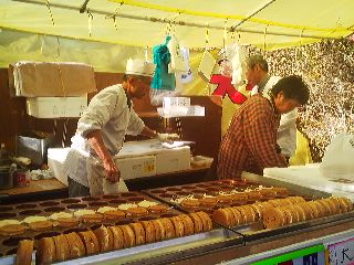Vendors making and selling OBAN YAKI- a kind of pancake filled with sweet bean paste and shaped like a big gold coin