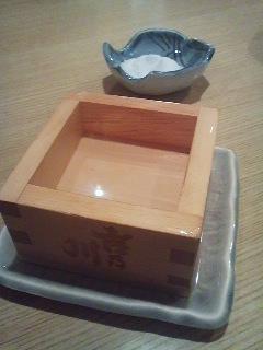 Taru-Zake (Sake from a cedar barrel) served in a cedar-wood box (MASU) which a oinch of salt on the rim