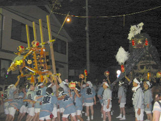 At the climax of the festival the SHISHI and the OMIKOSHI (portable shrine) can be seen battling each other