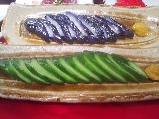 In a display window at a restaurant in Tsukuba- a platter of cooling summer vegetables: cucumber and eggplant