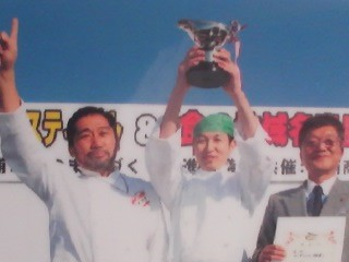 The mayor of Tsuchiura presenting a trophy to the winners of the curry cooking contest at last years Curry Festival