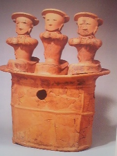Another unusual haniwa depicting three dancers on one base