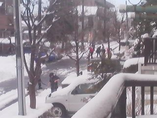 The whole neighborhood- men, women and children- out in force to clear the roads of snow(in the absence of city-provided snow-plowing services)