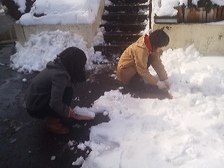 Clearing the heavy snowfall of January 9th with dust-pans!