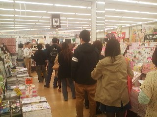 Unusually long lines at a bookstore in Tsukuba a few hours before the consumption tax jumps by 3 percent at midnight April 1st