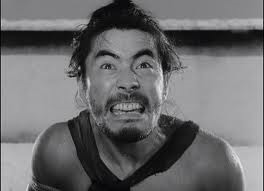 Always the ham, but a truly charismatic one, Toshiro Mifune plays the bandit Tajomaru who murders a samurai and rapes, the man`s wife. In the film the story is told from the perspective of EACH of the different characters involved- including the dead man`s. Th story line captures to the T, what the mood was like in post-war Japan when sitting among the ruins, with all they had been taught to be true suddenly discredited, the people were asking themselves: What happened? and What is truth?