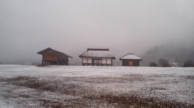 The reconstructed Hirasawa no Kanga buildings covered in a thin blanket of snow one winter