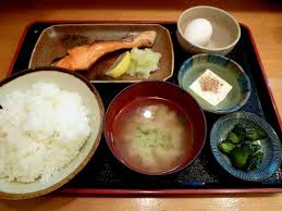 A piece of grilled salted salmon is part of a typical breakfast in eastern Japan