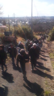 The local people manning the small hall beaneath the MAGAI BUTSU told me at 1 PM that only ten people, all of them locals come to worship that day - but on my way down I encountered this group- which had arrived by bus making their way up the trail! (January 15, 2015)