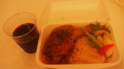 A lunch box with a glss of wine