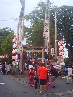 In front of the same shrine on the day of its summer festival