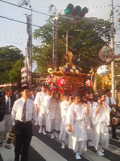 Carrying the OMIKOSHI (portable shrine) through the neighborhood