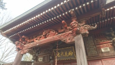 Another shot of the entrance to the Myoken Hall at Hokuto-Ji. The colorful banner is representative of the Shingon Sect and the carved dragon above protects (it is believed) the wooden structure from fire, and other beasts