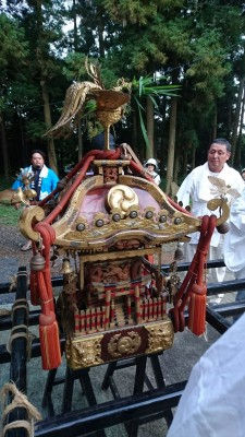 The O-Mikoshi (portable shrine) is taken down and then paraded through the village
