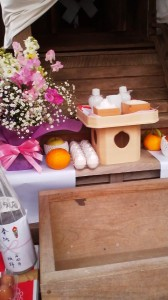 A packet of eggs among offerings left at the GASSUISEKI SHRINE (月水石神社).