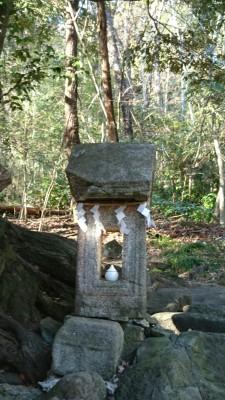 Diminutive stone shrine (ishi hokora) next to the main shrine.